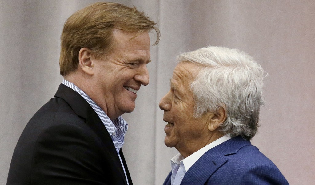 New England Patriots owner Robert Kraft, right, introduces NFL Commissioner Roger Goodell at a football safety clinic for mothers, Thursday, May 29, 2014 at the team's facilities in Foxborough, Mass. (AP Photo/Stephan Savoia)