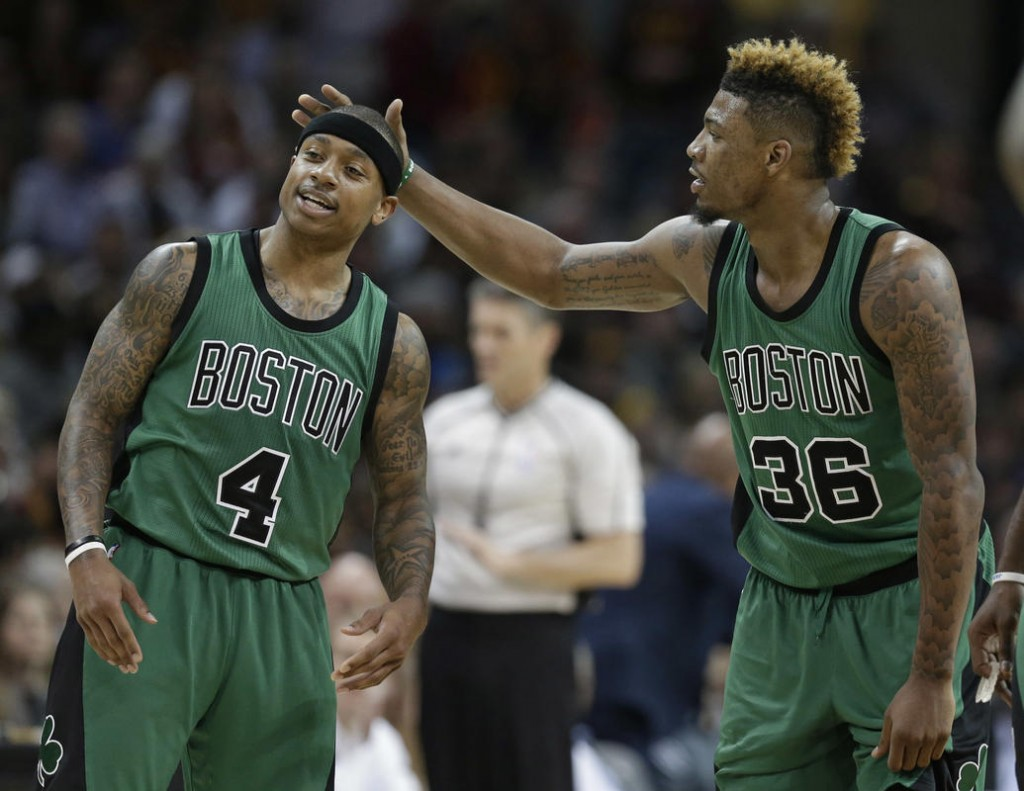 Boston Celtics' Marcus Smart (36) rubs Boston Celtics' Isaiah Thomas (4) head in the second half of an NBA basketball game against the Cleveland Cavaliers, Saturday, March 5, 2016, in Cleveland. (AP Photo/Tony Dejak)