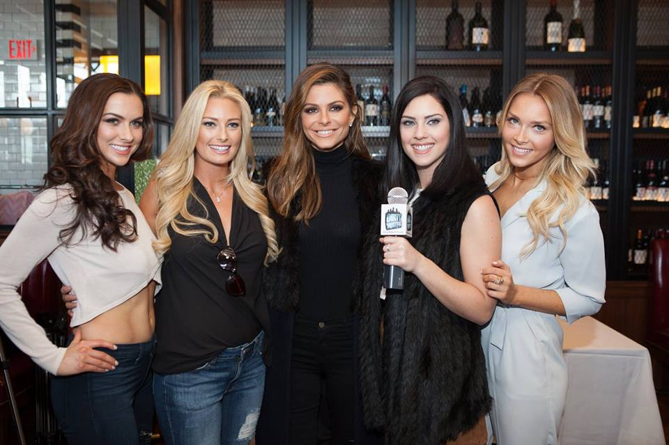 Julie Scaparotti reports for NESN's Dirty Water TV with (from left to right) Amanda Soucy, Jessica Strohm, Hollywood Celebrity Maria Menounos, Julia Scaparotti, and Camille Kostek.